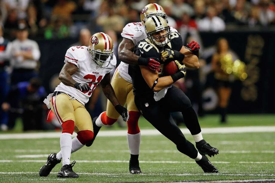 Jimmy Graham #80 of the New Orleans Saints is tackled by  Patrick Willis #52 of the San Francisco 49ers at The Mercedes-Benz Superdome on November 25, 2012 in New Orleans, Louisiana. Photo: Chris Graythen, Getty Images / 2012 Getty Images
