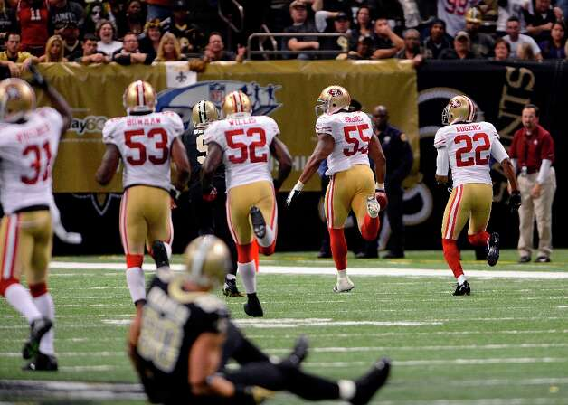 San Francisco 49ers outside linebacker Ahmad Brooks (55) carries an interception for a touchdown in the first half of an NFL football game against the New Orleans Saints at the Louisiana Superdome in New Orleans, Sunday, Nov. 25, 2012. Photo: Bill Feig, Associated Press / FR44286 AP
