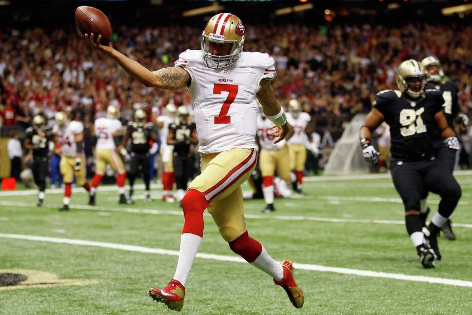 Quarterback Colin Kaepernick #7 of the San Francisco 49ers celebrates after scoring a touchdown against the New Orleans Saints at The Mercedes-Benz Superdome on November 25, 2012 in New Orleans, Louisiana. Photo: Chris Graythen, Getty Images / 2012 Getty Images