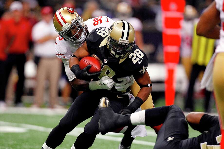 New Orleans Saints running back Mark Ingram (28) carries  as San Francisco 49ers outside linebacker Aldon Smith (99) tries to tackle in the first half of an NFL football game at the Louisiana Superdome in New Orleans, Sunday, Nov. 25, 2012. Photo: Gerald Herbert, Associated Press / AP