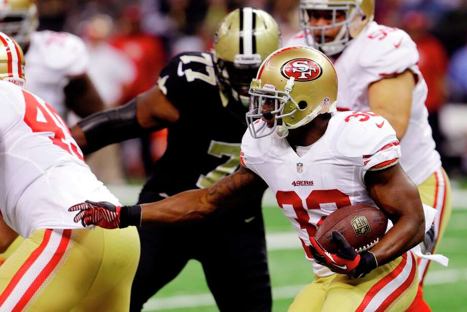 San Francisco 49ers running back Kendall Hunter (32) carries in the first half of an NFL football game against the New Orleans Saints in New Orleans, Sunday, Nov. 25, 2012. Photo: Bill Haber, Associated Press / FR170136 AP