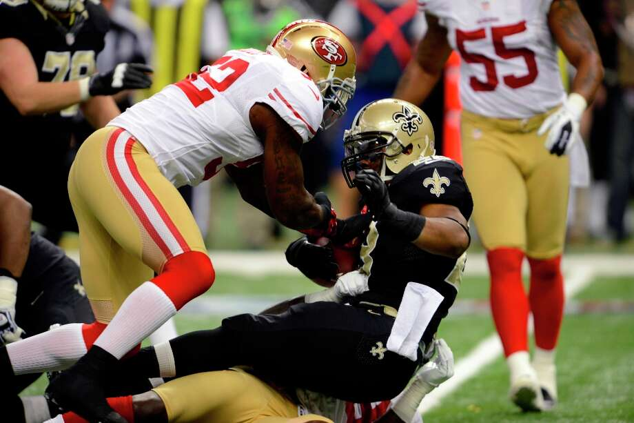 New Orleans Saints running back Mark Ingram (28) it tackled in the first half of an NFL football game against the San Francisco 49ers at the Louisiana Superdome in New Orleans, Sunday, Nov. 25, 2012. Photo: Bill Feig, Associated Press / FR44286 AP