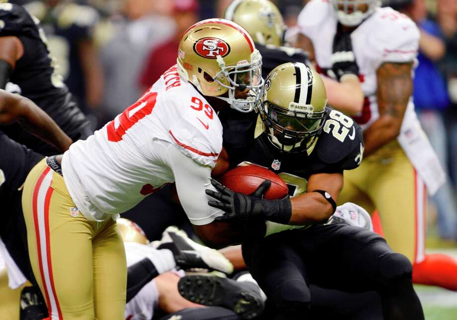 New Orleans Saints running back Mark Ingram (28) is tackled by San Francisco 49ers outside linebacker Aldon Smith (99) in the first half of an NFL football game at the Louisiana Superdome in New Orleans, Sunday, Nov. 25, 2012. Photo: Bill Feig, Associated Press / FR44286 AP