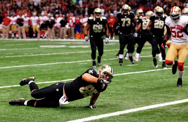New Orleans Saints tight end David Thomas (85) crawls over the goal line for a touchdown in the first half of an NFL football game against the San Francisco 49ers in New Orleans, Sunday, Nov. 25, 2012. Photo: Bill Haber, Associated Press / FR170136 AP