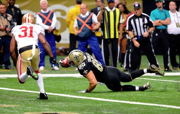 New Orleans Saints tight end David Thomas (85) scores as he crawls across the goal line in the first half of an NFL football game against the San Francisco 49ers at the Louisiana Superdome in New Orleans, Sunday, Nov. 25, 2012. Photo: Bill Feig, Associated Press / FR44286 AP