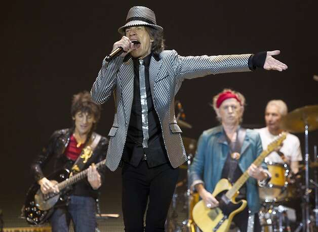Mick Jagger sings as the Rolling Stones play their first 50th anniversary concert at London's O2 arena, with help from bandmates Ronnie Wood (left), Keith Richards and Charlie Watts. Photo: Joel Ryan, Associated Press