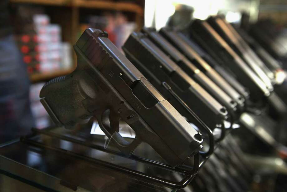 Pistols are offered for sale at Freddie Bear Sports on October 18, 2012 in Tinley Park, Illinois. Photo: Scott Olson, Staff / 2012 Getty Images