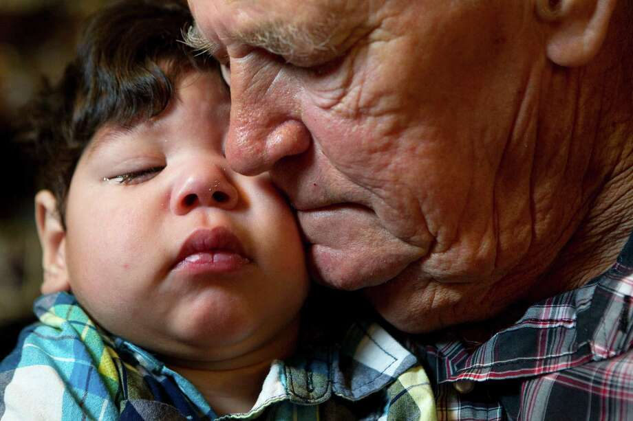 "A union painter by trade with a hard exterior, the heart of Geheard Jurek, 67, is softened by soon to be adopted 22-month-old Anthony at his home in Angleton. ""I love the babies,"" he said. He and wife Judy have been foster parents for dozens of kids. Photo: Johnny Hanson, Staff / © 2012  Houston Chronicle"