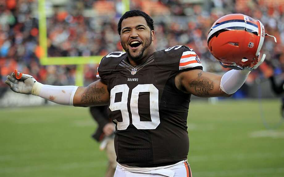 Browns defensive lineman Billy Winn celebrates his team's 20-14 victory over the rival Steelers in Cleveland. Photo: Tony Dejak, Associated Press