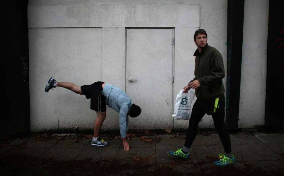 A runner stretches before the Amica Insurance Seattle Marathon. Photo: JOSHUA TRUJILLO / SEATTLEPI.COM