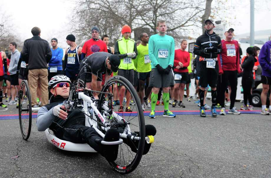 Wheelchair athlete Richard Le prepares for the Seattle Marathon. Photo: Lindsey Wasson  / SEATTLEPI.COM