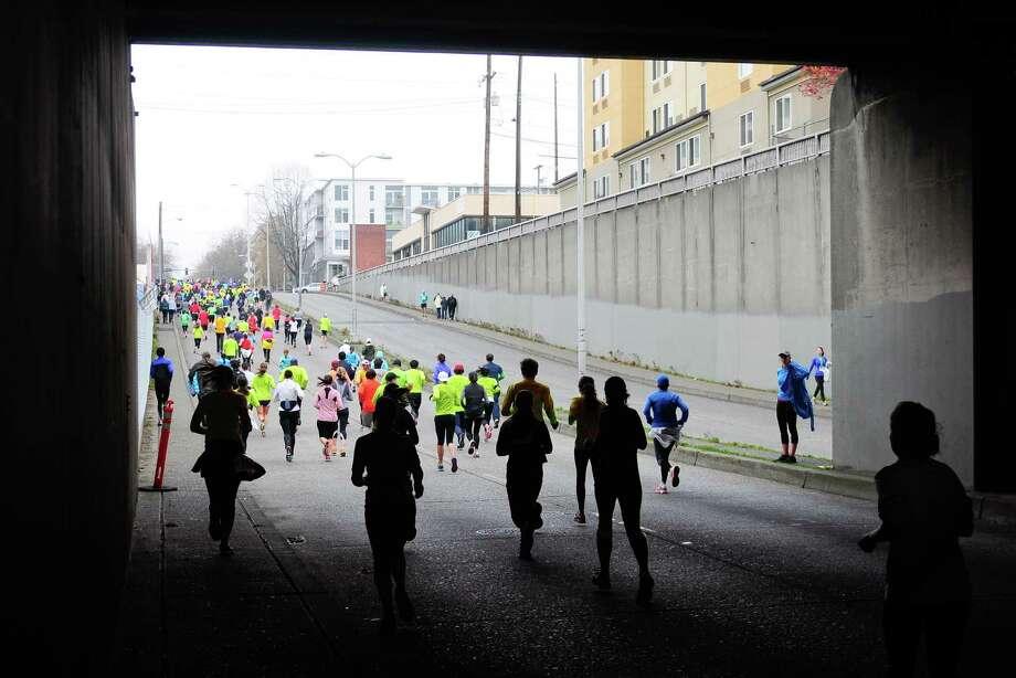 Half marathon participants make their way under Aurora Ave. Photo: Lindsey Wasson  / SEATTLEPI.COM