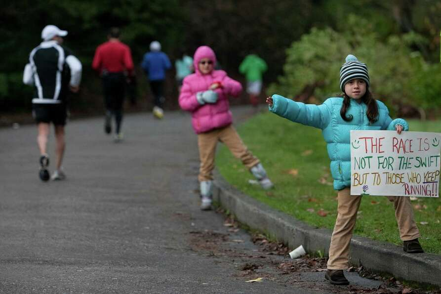 Young supporters line the course along East Interlaken Boulevard.