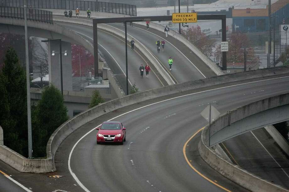 Runners enter the Interstate 90 express lanes during the Amica Insurance Seattle Marathon. Photo: JOSHUA TRUJILLO / SEATTLEPI.COM