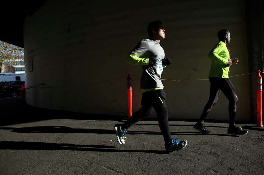 Runners enter Memorial Stadium. Photo: JOSHUA TRUJILLO / SEATTLEPI.COM