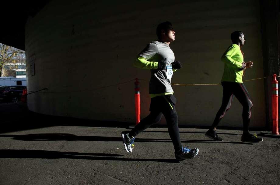 Runners enter Memorial Stadium. Photo: JOSHUA TRUJILLO / SEATTLEPI.COM