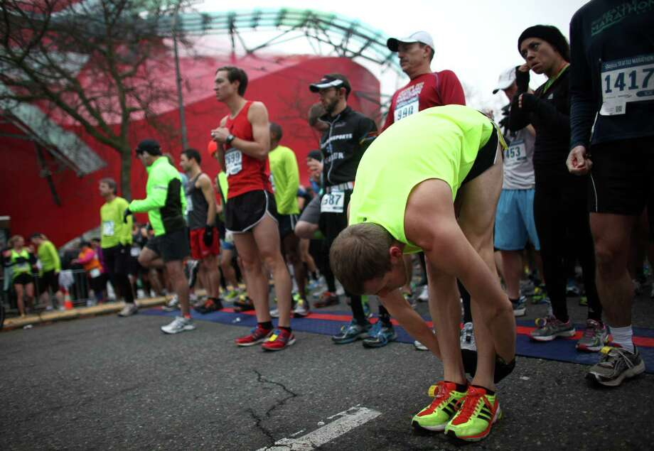 Runners stretch at the start line. Photo: JOSHUA TRUJILLO / SEATTLEPI.COM