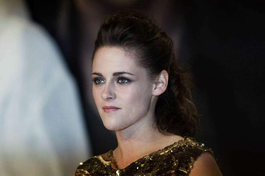 """Actress Kristen Stewart attends the German premiere of """"The Twilight Saga: Breaking Dawn Part II"""" in Berlin, Friday, Nov. 16, 2012. (AP Photo/Markus Schreiber) Photo: Markus Schreiber, Associated Press / AP"""