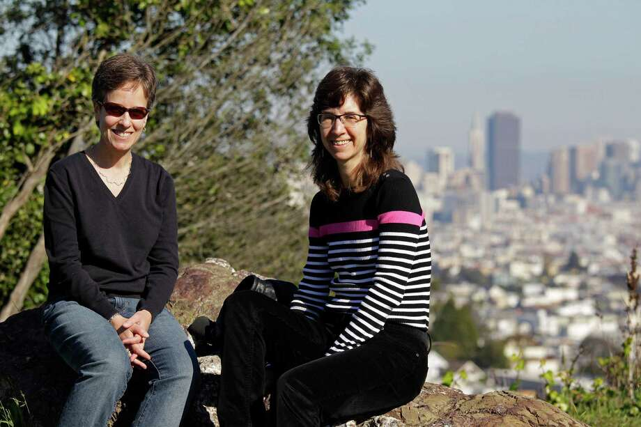 Karen Golinski, right, of San Francisco, was denied benefits for her spouse, Amy Cunninghis, in 2008. Four years later, her request still is being debated. Photo: Eric Risberg, STF / AP