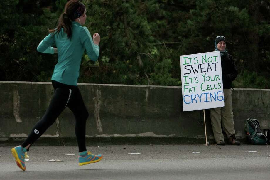 A spectator holds a sign during the Amica Insurance Seattle Marathon on Sunday, November 25, 2012. More than 15,000 runners hit the streets for the annual Seattle Marathon. Photo: JOSHUA TRUJILLO / SEATTLEPI.COM