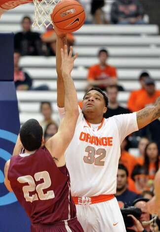 Syracuse's Dajuan Coleman (32)blocks a shot by Colgate's Brandon James during the first half of an NCAA college basketball game in Syracuse, N.Y., Sunday, Nov. 25, 2012. (AP Photo/Kevin Rivoli) Photo: Kevin Rivoli