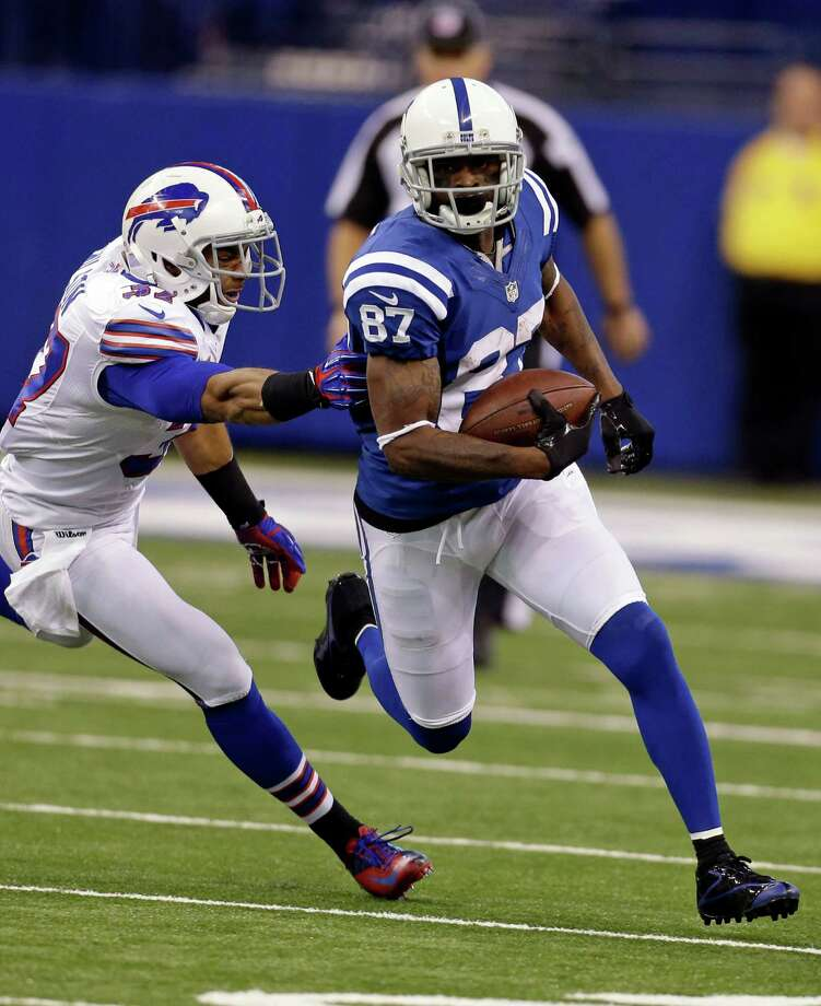Indianapolis Colts wide receiver Reggie Wayne, right, is tackled by Buffalo Bills strong safety George Wilson after making a catch during the second half of an NFL football game in Indianapolis, Sunday, Nov. 25, 2012. (AP Photo/Darron Cummings) Photo: Darron Cummings