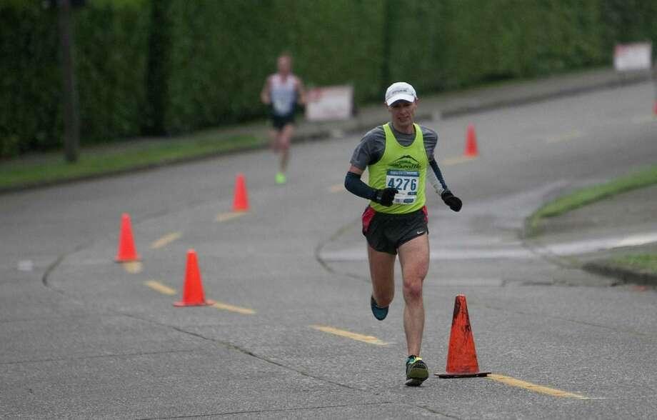 Marathon winner Uli Steidl leads the pack along Lake Washington Boulevard during the Amica Insurance Seattle Marathon on Sunday, November 25, 2012. More than 15,000 runners hit the streets for the annual Seattle Marathon. Photo: JOSHUA TRUJILLO / SEATTLEPI.COM