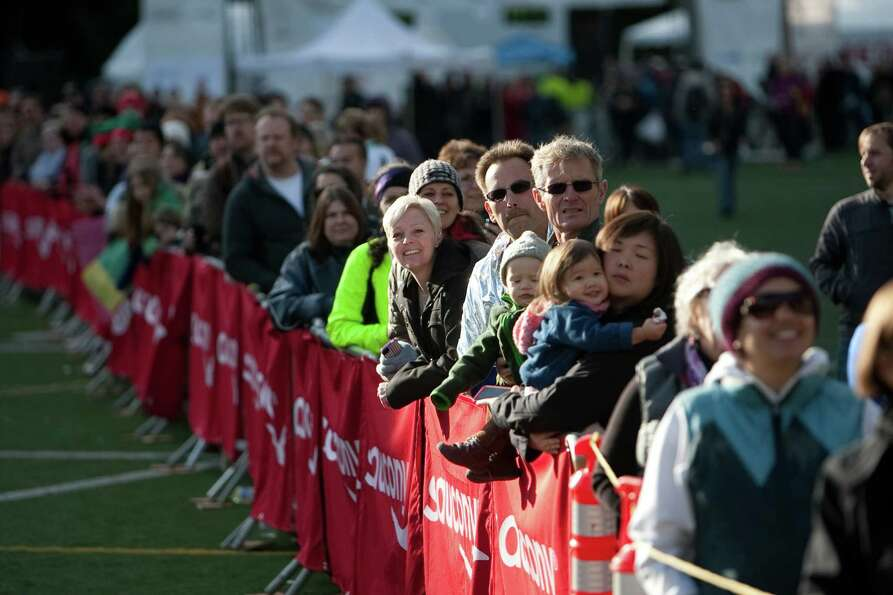 Spectators gather at the finish line during the Amica Insurance Seattle Marathon on Sunday, November