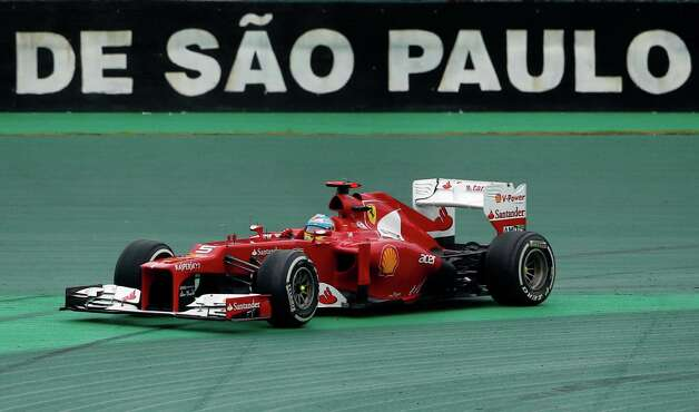 Ferrari driver Fernando Alonso of Spain goes briefly off the track during the Formula One Brazilian Grand Prix at the Interlagos race track in Sao Paulo, Brazil, Sunday, Nov. 25, 2012. (AP Photo/Silvia Izquierdo) Photo: Silvia Izquierdo