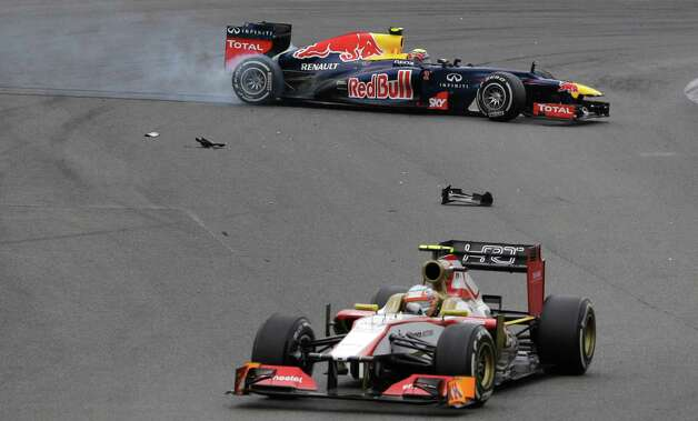 Red Bull driver Mark Webber of Australia, back, steers his car after colliding during the Formula One Brazilian Grand Prix at the Interlagos race track in Sao Paulo, Brazil, Sunday, Nov. 25, 2012. (AP Photo/Ricardo Mazalan) Photo: Ricardo Mazalan