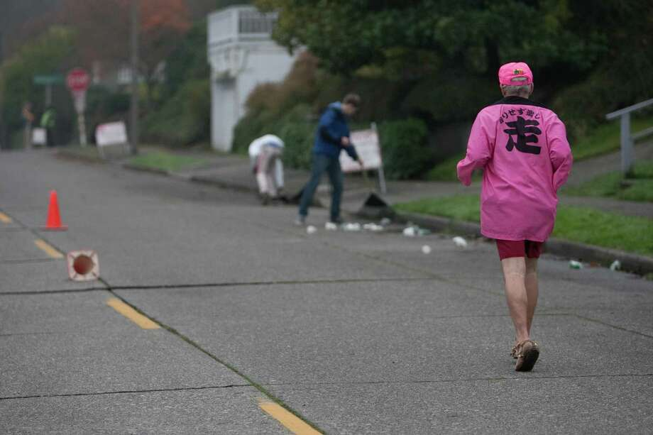A runner makes his way along the route during the Amica Insurance Seattle Marathon on Sunday, November 25, 2012. More than 15,000 runners hit the streets for the annual Seattle Marathon. Photo: JOSHUA TRUJILLO / SEATTLEPI.COM