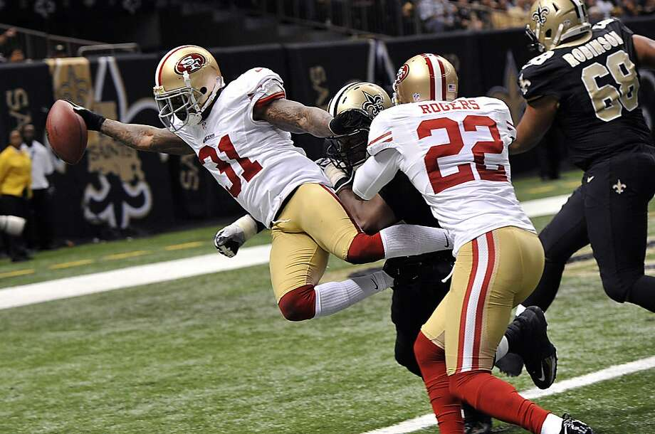 Donte Whitner finishes his interception return with a leap into the end zone in the third quarter, putting the 49ers up 28-14. Photo: Bill Feig, Associated Press