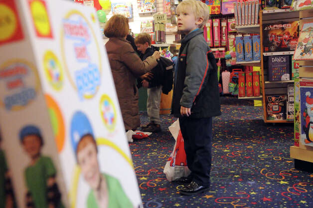 Leo Ford, 6, shops at Smart Kids' Toys on East Elm Street in Greenwich, Conn., Nov. 25, 2012. Photo: Keelin Daly / Stamford Advocate Riverbend Stamford, CT