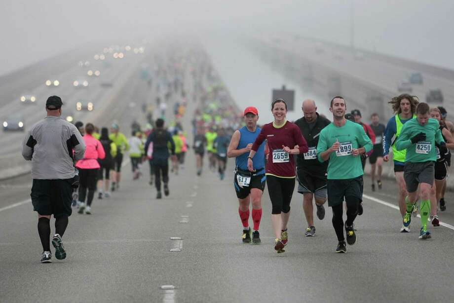 Runners cross the Interstate 90 floating bridge during the Amica Insurance Seattle Marathon on Sunday, November 25, 2012. More than 15,000 runners hit the streets for the annual Seattle Marathon. Photo: JOSHUA TRUJILLO / SEATTLEPI.COM