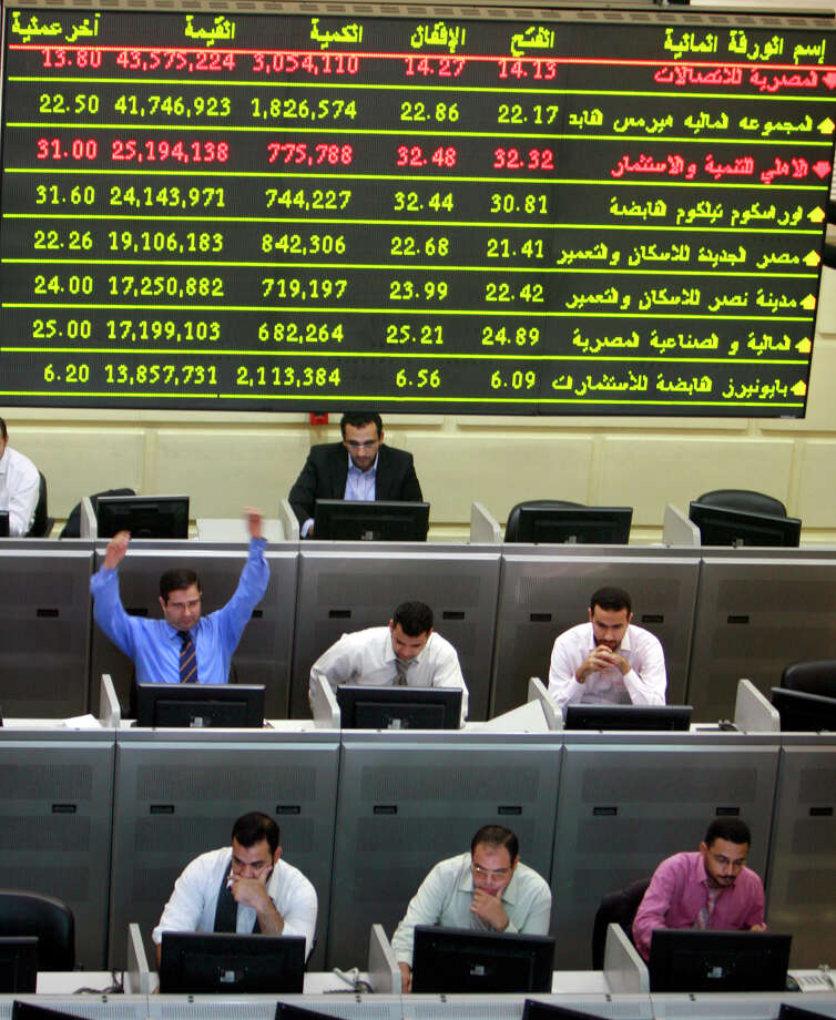FILE - In this Wednesday, Oct. 29, 2008 file photo, an Egyptian broker gestures during a session at the Egyptian stock market in Cairo, Egypt. Egypt's benchmark stock index on Sunday plunged by more than 9.5 percent in the first trading session since the country's Islamist president issued decrees to assume sweeping new powers, while police in central Cairo fired tear gas at protesters who accuse the Egyptian leader of a blatant power grab. (AP Photo/Amr Nabil, File) Photo: Amr Nabile, STF / AP