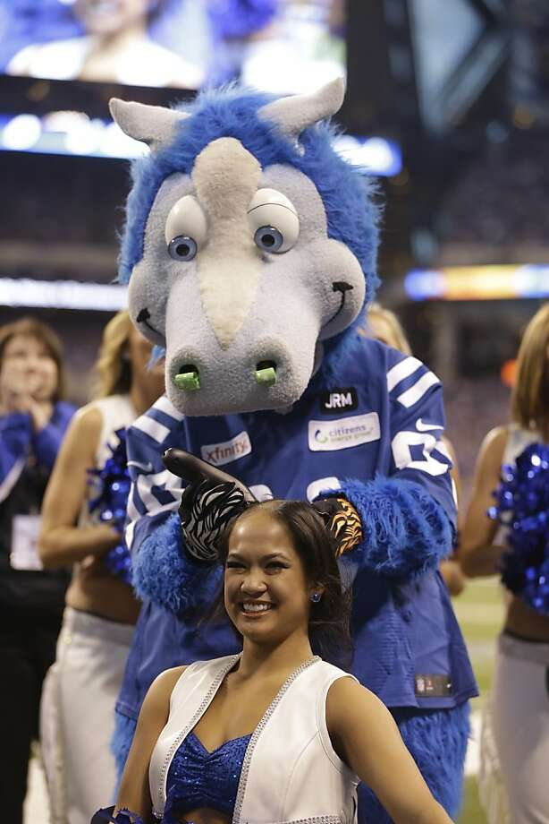 Indianapolis Colts cheerleader Crystal Ann has her head shaved by the Blue the Colts mascot during the second half of an NFL football game between the Indianapolis Colts and the Buffalo Bills in Indianapolis, Sunday, Nov. 25, 2012. Money was raised for leukemia research in honor of head coach Chuck Pagano.  (AP Photo/Darron Cummings) Photo: Darron Cummings, Associated Press