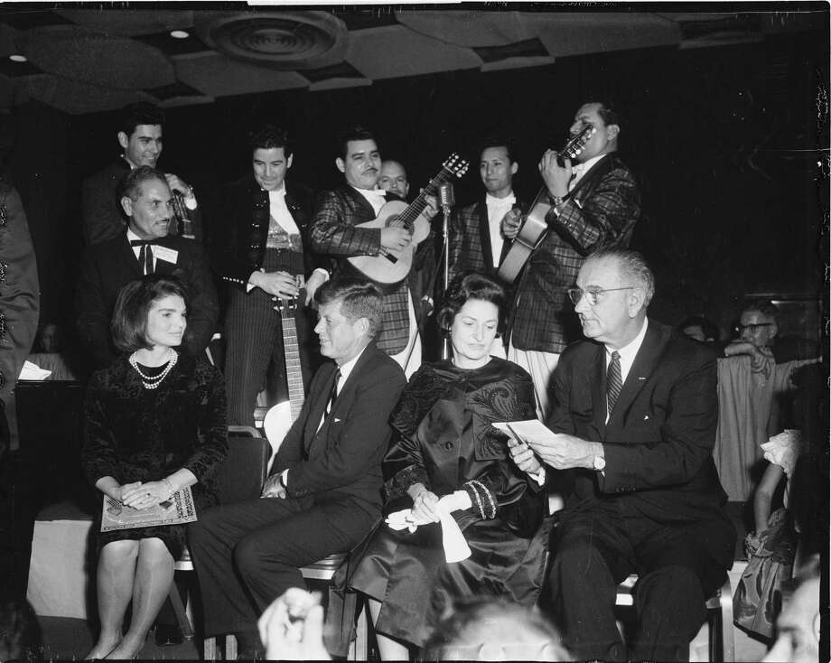 Mariachis serenade first lady Jackie Kennedy, left, President John F. Kennedy, Lady Bird Johnson and Vice President Lyndon Johnson at a LULAC dinner at the Rice Hotel in Houston on Nov. 21. 1963, the night before the president was killed in Dallas. Photo: HC Staff / Houston Chronicle