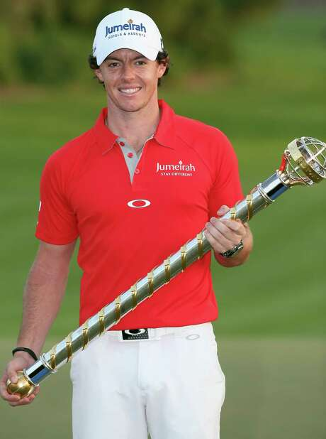 DUBAI, UNITED ARAB EMIRATES - NOVEMBER 25:  Rory McIlroy of Northern Ireland poses with the trophy after winning the DP World Tour Championship on the Earth Course at Jumeirah Golf Estates on November 25, 2012 in Dubai, United Arab Emirates.  (Photo by Andrew Redington/Getty Images) Photo: Andrew Redington, Staff / 2012 Getty Images