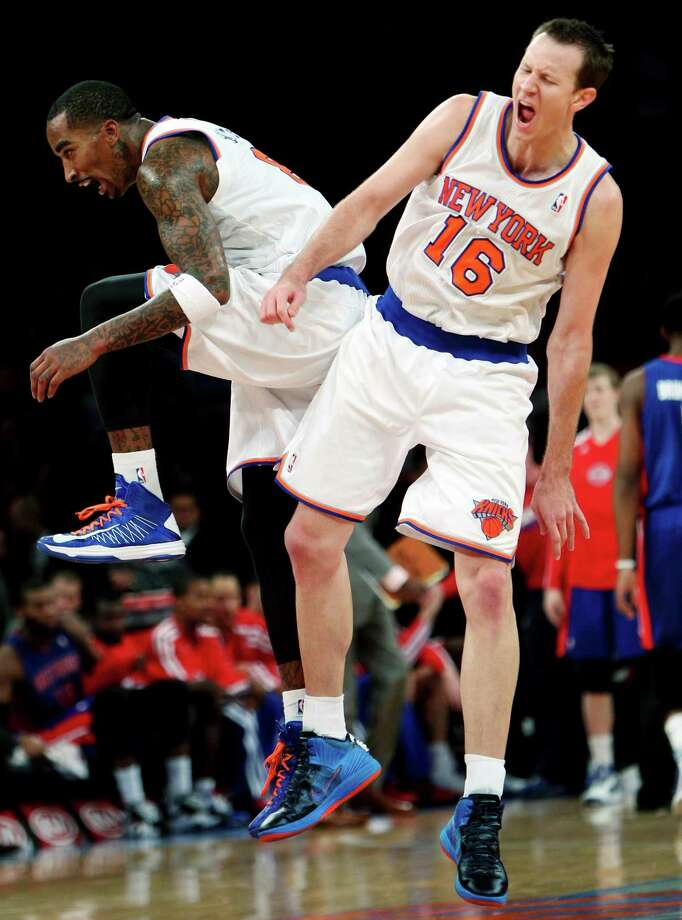 New York Knicks' J.R. Smith, left, and Steve Novak celebrate during the second half of an NBA basketball game against the Detroit Pistons in New York, Sunday, Nov. 25, 2012. The Knicks won 121-100. (AP Photo/Seth Wenig) Photo: Seth Wenig