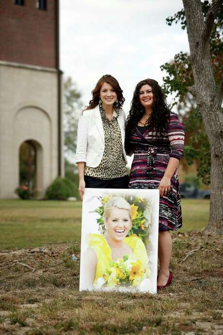 Pope John XXIII High School's director of advancement, Candace Brawner, left, and Lynsey Hepburn, director of admissions, with a portrait of Meagan Jones, former director of admissions, who was killed by a drunken driver in October. Photo: TODD SPOTH, PHOTOGRAPHER / © TODD SPOTH, 2012