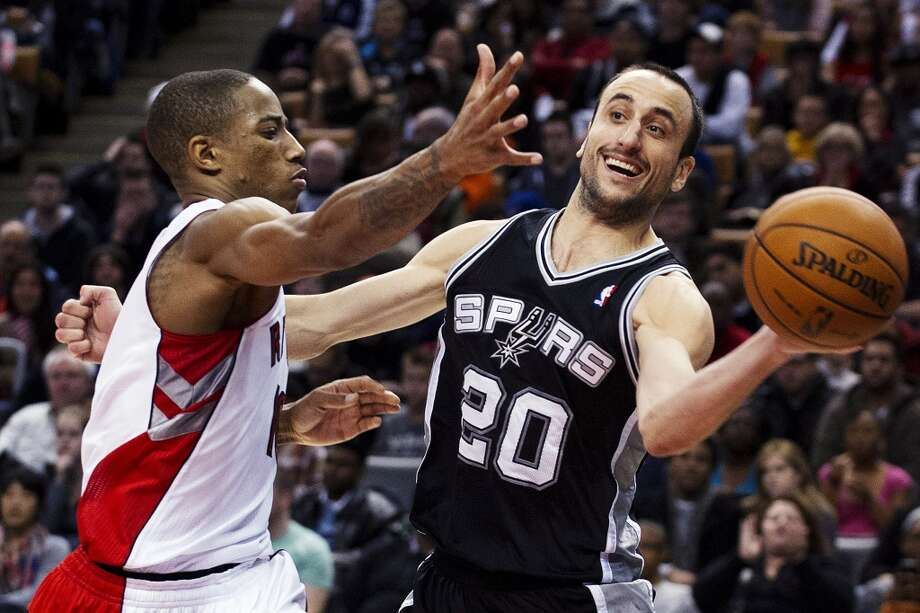 San Antonio Spurs' Manu Ginobili (20) passes the ball around Toronto Raptors' DeMar DeRozan during the second half of an NBA basketball game, Sunday, Nov. 25, 2012, in Toronto. The Spurs won 111-106. (AP Photo/The Canadian Press, Aaron Vincent Elkaim) (Associated Press)
