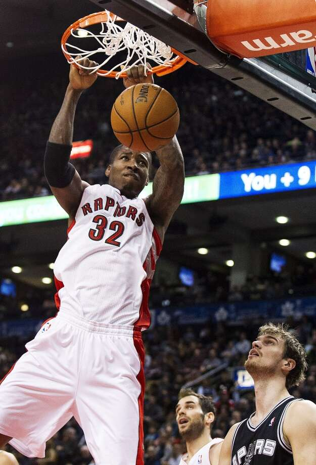 Toronto Raptors' Ed Davis (32) dunks as San Antonio Spurs' Tiago Splitter, bottom right, watches during the first half of an NBA basketball game, Sunday, Nov. 25, 2012, in Toronto. (AP Photo/The Canadian Press, Aaron Vincent Elkaim) (Associated Press)