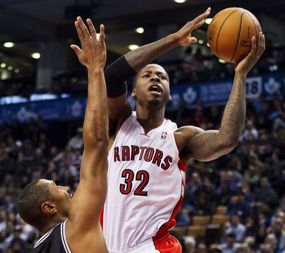 Toronto Raptors' Ed Davis (32) drives to the basket against the San Antonio Spurs during the first half of an NBA basketball game, Sunday, Nov. 25, 2012, in Toronto. (AP Photo/The Canadian Press, Aaron Vincent Elkaim) (Associated Press)