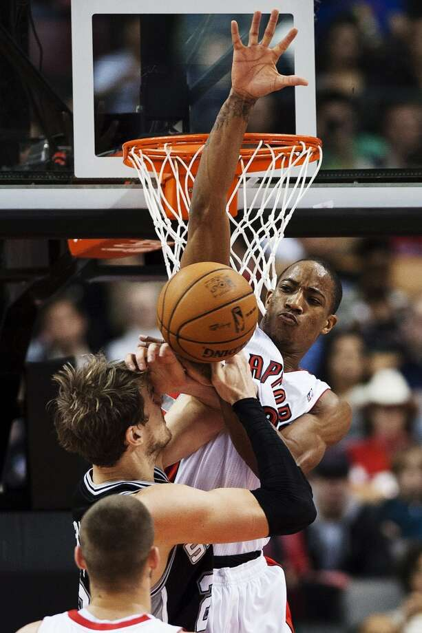 Toronto Raptors' DeMar DeRozan, right, fouls San Antonio Spurs' Tiago Splitter during the first half of an NBA basketball game, Sunday, Nov. 25, 2012, in Toronto. (AP Photo/The Canadian Press, Aaron Vincent Elkaim) (Associated Press)