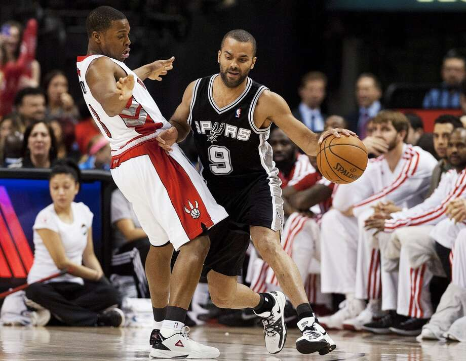 Toronto Raptors' Kyle Lowry, left, defends San Antonio Spurs' Tony Parker (9) during the first half of an NBA basketball game, Sunday, Nov. 25, 2012, in Toronto. (AP Photo/The Canadian Press, Aaron Vincent Elkaim) (Associated Press)
