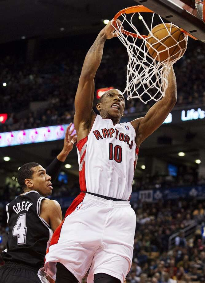 Toronto Raptors' DeMar DeRozan (10) dunks against San Antonio Spurs' Danny Green (4) during the first half of an NBA basketball game, Sunday, Nov. 25, 2012, in Toronto. (AP Photo/The Canadian Press, Aaron Vincent Elkaim) (Associated Press)