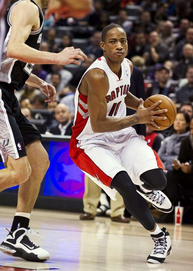 Toronto Raptors' DeMar DeRozan drives to the basket against the San Antonio Spurs during the first half of an NBA basketball game, Sunday, Nov. 25, 2012, in Toronto. (AP Photo/The Canadian Press, Aaron Vincent Elkaim) (Associated Press)