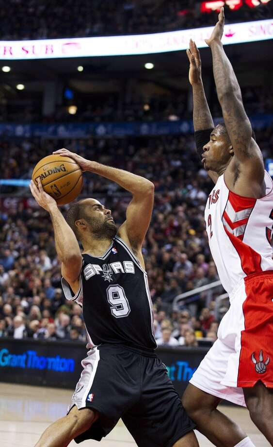 San Antonio Spurs' Tony Parker (9) is challenged by Toronto Raptors' Ed Davis during the second half of an NBA basketball game, Sunday, Nov. 25, 2012, in Toronto. The Spurs won 111-106. (AP Photo/The Canadian Press, Aaron Vincent Elkaim) (Associated Press)