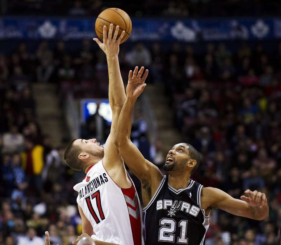 Toronto Raptors' Jonas Valanciunas (17) wins the tip-off against San Antonio Spurs' Tim Duncan (21) during the first half of an NBA basketball game, Sunday, Nov. 25, 2012, in Toronto. (AP Photo/The Canadian Press, Aaron Vincent Elkaim) (Associated Press)