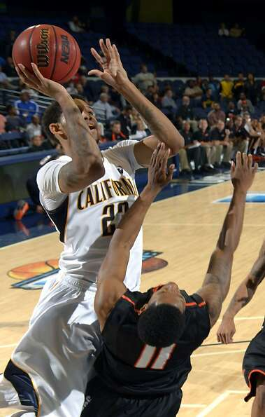 Allen Crabbe, who scored 24 points to lead Cal, shoots over Pacific's Lorenzo McCloud.